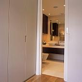 A view through a sliding door into a bathroom