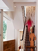 Renovated house with traditional staircase and modern art installation