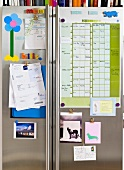 Magnetic message board with calendar, postcards etc.
