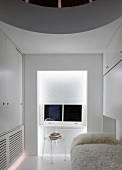 White guest room with flokati blanket on bed and transparent Plexiglas chair in front of window
