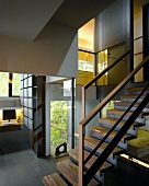 Open stairwell in contemporary house with interior and exterior views