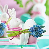 Easter bunny egg cups decorated with hyacinth flowers