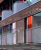 Modern house facade with balcony and horizontal wooden slat cladding
