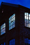 Old factory illuminated in the evening