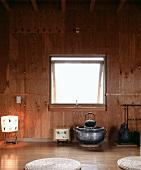 Simple Japanese tea room with wood-clad wall