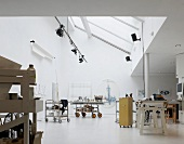 Various trolleys in artist's studio under ceiling with skylights