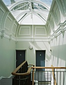 Staircase with modern glass roof in classical villa