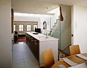 Open-plan living space with dining area in front of kitchen