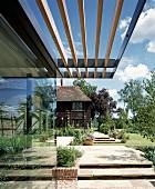 Sun screen porch of wooden slats on modern glass facade