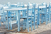 Tables belonging to a Greek taverna on a beach