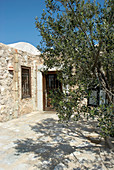 Stone house with olive tree in courtyard (Tunisia)