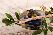 A fountain pen, a bottle of ink and a letter