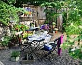 Set table laid in flowering garden
