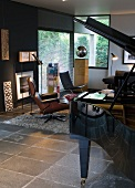 Black grand piano in modern interior with grey tiled floor