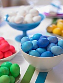 Bowls of Colored Easter Eggs on a Table