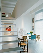 Floating stairs and dining area in open-plan living space