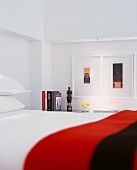 Detail of bedroom with framed pictures above shelf