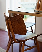 50s-style wooden chair at a table