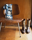 Cowboy boots next to 50s-style chair
