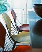 Wire mesh chairs with leather covers