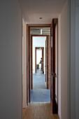 View through row of narrow, open doors
