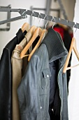 Jackets on coathangers on clothes rail