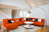 Orange sofa combination and arc lamp in living room of Swedish timber-framed house
