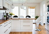 White fitted kitchen with breakfast bar