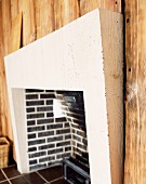 Brick fireplace and wall with wooden cladding