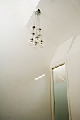 Pendant lamp in white room
