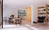 Open-plan room with living and dining areas