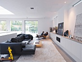 Generous living room with black sofa