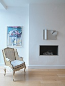 Armchair in front of built-in fireplace
