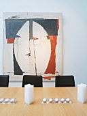 Large painting behind dining table