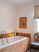 Chair next to bathtub