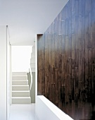 Wood-clad wall next to stairs