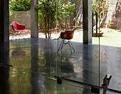 View of veranda and courtyard through glass doors