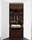Open door leading to walk-in wardrobe