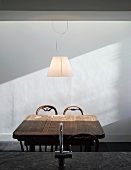 Rustic wooden dining table & chairs with modern pendant lamp