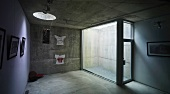 Cellar with concrete walls, round skylight & glass emergency exit