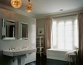 Bathroom with bathtub, double sinks & mirrors