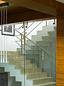 Glass stairwell with metal handrail