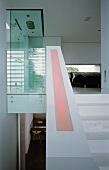 Staircase to glass shower cubicle & bedroom