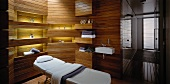 Spa & massage room with wood panelling