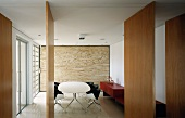 Dining room with table, chairs & free-standing wooden partitions