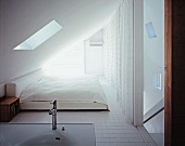 Bedroom with sink under sloping attic roof