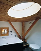 Bathroom with wooden ceiling, wooden beams & round skylight