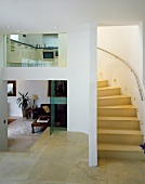 Staircase leading from living space to kitchen