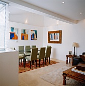 Dining area with table, chairs & paintings