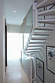 Light stairwell with glass balustrade